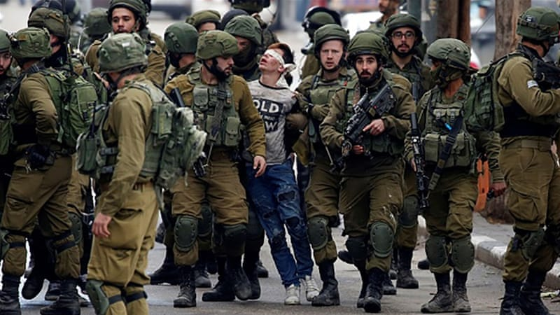 'Beaten' Palestinian boy in viral photo to face charges